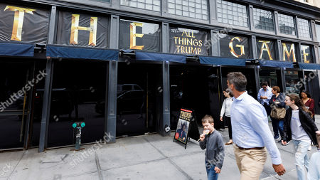 People walk past the exterior of Andres Serrano's installation 'The Game: All Things Trump', a display of over 1,000 pieces of Donald Trump-related memorabilia and souvenirs collected by Serrano, in New York, New York, USA, 25 April 2019. The items in the installation, which Serrano purchased over the past year at auctions and on eBay, span from Trump's early days in the New York, to his days on television and up to the present day.
