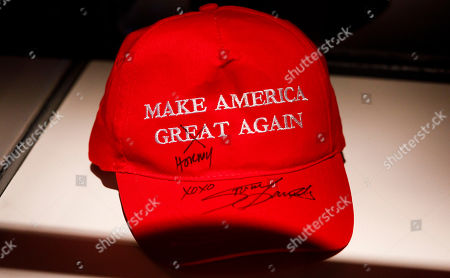 A Trump campaign hat signed by Stormy Daniels on display in Andres Serrano's installation 'The Game: All Things Trump', a display of over 1,000 pieces of Donald Trump-related memorabilia and souvenirs collected by Serrano, in New York, New York, USA, 25 April 2019. The items in the installation, which Serrano purchased over the past year at auctions and on eBay, span from Trump's early days in the New York, to his days on television and up to the present day.