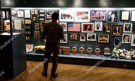 A man looks at pictures, games, and magazines on display in Andres Serrano's installation 'The Game: All Things Trump', a display of over 1,000 pieces of Donald Trump-related memorabilia and souvenirs collected by Serrano, in New York, New York, USA, 25 April 2019. The items in the installation, which Serrano purchased over the past year at auctions and on eBay, span from Trump's early days in the New York, to his days on television and up to the present day.