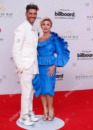 Erick Elias, Karla Guindi. Erick Elias, left, and Karla Guindi arrive at the Billboard Latin Music Awards, at the Mandalay Bay Events Center in Las Vegas