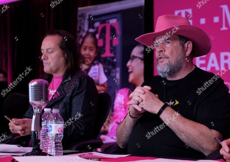 T-Mobile CFO Braxton Carter, right, answers a caller's questions while CEO John Legere listens, during the T-Mobile Q1 2019 Earnings Call on in Bellevue, Wash. T-Mobile delivered all-time record-low postpaid phone churn of 0.88% in Q1 2019