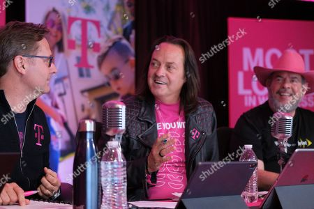 T-Mobile CEO John Legere, center, answers a caller's questions President Mike Sievert, left, and CFO Braxton Carter listen during the T-Mobile Q1 2019 Earnings Call on in Bellevue, Wash. The Un-Carrier is off to a fast start to the year, delivering record-high service revenues, record Q1 net income and record adjusted EBITDA