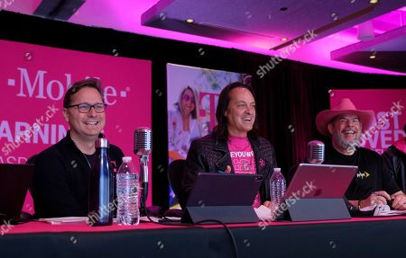 T-Mobile CEO John Legere, center, along with President Mike Sievert, left, and CFO Braxton Carter celebrate while reporting record financials during a live webcast on in Bellevue, Wash. In Q1, the company reported record-high service revenues of $8.3 billion, up six percent in Q1 2019 with branded postpaid service revenues up eight percent