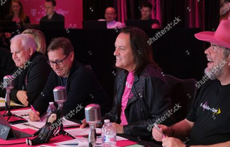 T-Mobile CEO John Legere, second from right, answers caller questions, while taking part inthe T-Mobile Q1 2019 earnings call with President Mike Sievert, second from left, CFO Braxton Carter, far right, and Chief Technology Officer Neville Ray, on in Bellevue, Wash. The Un-Carrier reported another record-breaking quarter and is confident in the business as they prepare to join forces with Sprint