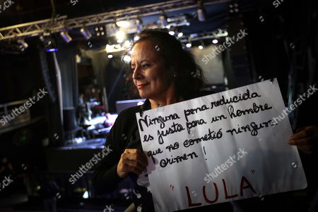A woman holds a sign that reads 'No reduced penalty is fair for a man who did not commit any crime, Lula' as Brazilian former president Dilma Rousseff takes part in an event in Buenos Aires, Argentina, 25 April 2019, The woman demanded freedom for Brazilian former president Luiz Inacio Lula da Silva, a year after his incarceration.