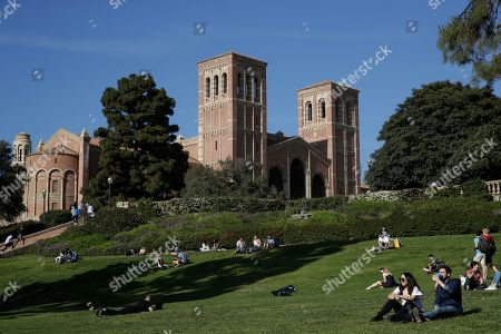 Stock Photo of Students sit on the lawn near Royce Hall at UCLA, in the Westwood section of Los Angeles. Hundreds of students and staff at two Los Angeles universities, including UCLA, have been placed under quarantine because they may have been exposed to measles. Officials say the people affected by the order either have not been vaccinated or cannot verify that they are immune