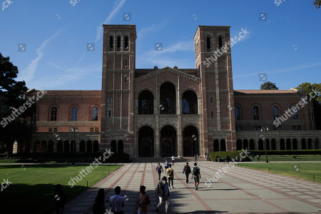 Students walk past Royce Hall at the University of California, Los Angeles, in the Westwood section of Los Angeles. Hundreds of students and staff at two Los Angeles universities, including UCLA, have been placed under quarantine because they may have been exposed to measles. Officials say the people affected by the order either have not been vaccinated or cannot verify that they are immune