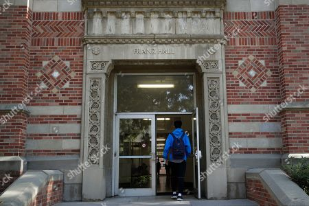Stock Picture of A student enters Franz Hall at University of California, Los Angeles, in the Westwood section of Los Angeles. Hundreds of students and staff at two Los Angeles universities, including UCLA, have been placed under quarantine because they may have been exposed to measles and either have not been vaccinated or cannot verify that they are immune, officials said Thursday