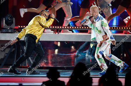 Sean Paul, J Balvin. Sean Paul, left, and J Balvin perform a medley at the Billboard Latin Music Awards, at the Mandalay Bay Events Center in Las Vegas