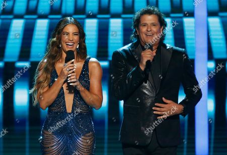 Gaby Espino, Carlos Vives. Gaby Espino, left, and Carlos Vives speak at the Billboard Latin Music Awards, at the Mandalay Bay Events Center in Las Vegas