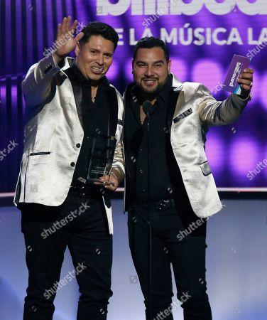 Oswaldo Silvas, Alan Ramirez. Oswaldo Silvas, left, and Alan Ramirez, of Banda Sinaloense MS de Sergio Lizarraga, accept the award for regional Mexican artist of the year, duo or group, at the Billboard Latin Music Awards, at the Mandalay Bay Events Center in Las Vegas