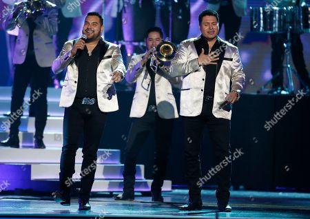 Alan Ramirez, Oswaldo Silvas. Alan Ramirez, left, and Oswaldo Silvas, of Banda Sinaloense MS de Sergio Lizarraga, perform at the Billboard Latin Music Awards, at the Mandalay Bay Events Center in Las Vegas