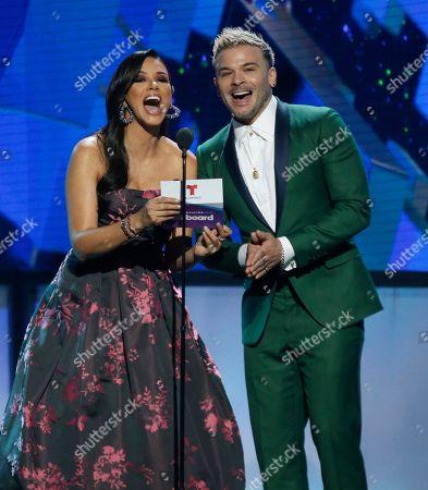 Ana Jurka, Pedro Cap. Ana Jurka, left, and Pedro Cap present the award for digital song of the year at the Billboard Latin Music Awards, at the Mandalay Bay Events Center in Las Vegas