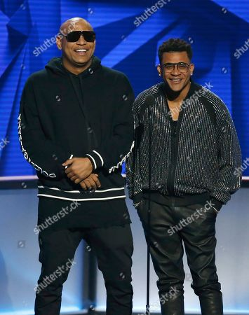 Stock Photo of Alexander Delgado, Randy Malcom Martinez. Alexander Delgado, left, and Randy Malcom Martinez, of Gente De Zona, present the award for hot Latin songs female artist of the year at the Billboard Latin Music Awards, at the Mandalay Bay Events Center in Las Vegas
