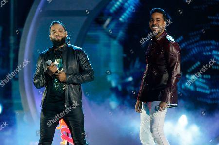 Stock Photo of Romeo Santos, Henry Santos. Romeo Santos, right, and Henry Santos, of Aventura, perform at the Billboard Latin Music Awards, at the Mandalay Bay Events Center in Las Vegas