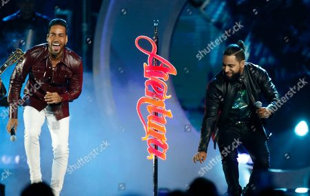 Romeo Santos, Henry Santos. Romeo Santos, left, and Henry Santos, of Aventura, perform at the Billboard Latin Music Awards, at the Mandalay Bay Events Center in Las Vegas