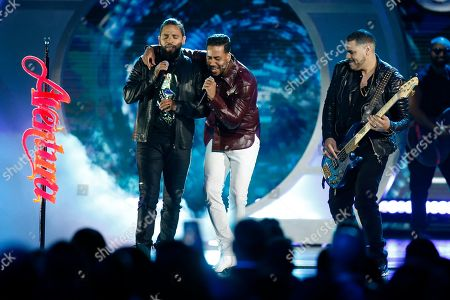 Stock Image of Romeo Santos, Henry Santos, Lenny Santos. Henry Santos, from left, Romeo Santos and Lenny Santos, of Aventura, perform at the Billboard Latin Music Awards, at the Mandalay Bay Events Center in Las Vegas