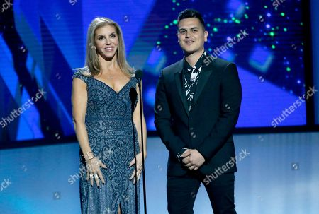 Leila Cobo, Regulo Caro. Leila Cobo, left, and Regulo Caro present the award for Latin pop song of the year at the Billboard Latin Music Awards, at the Mandalay Bay Events Center in Las Vegas