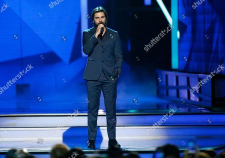 Juanes introduces a tribute to Juan Luis Guerra at the Billboard Latin Music Awards, at the Mandalay Bay Events Center in Las Vegas