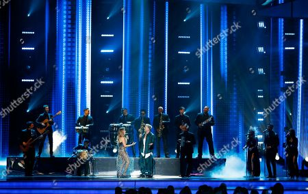 Kany Garcia, Pedro Capo. Kany Garcia, left, and Pedro Capo perform a tribute to Juan Luis Guerra at the Billboard Latin Music Awards, at the Mandalay Bay Events Center in Las Vegas