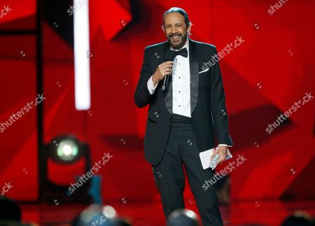 Juan Luis Guerra accepts a lifetime achievement award at the Billboard Latin Music Awards, at the Mandalay Bay Events Center in Las Vegas