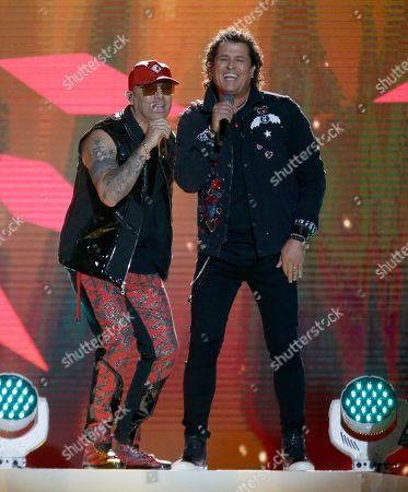 "Wisin, Carlos Vives. Wisin, left, and Carlos Vives perform ""Si Me Das Tu Amor"" at the Billboard Latin Music Awards, at the Mandalay Bay Events Center in Las Vegas"