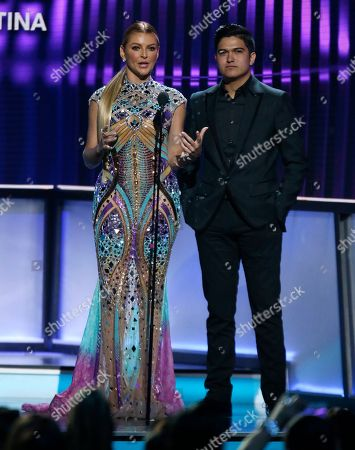 Marjorie De Sousa, Ulices Chaidez. Marjorie De Sousa, left, and Ulices Chaidez present the award for hot Latin song of the year at the Billboard Latin Music Awards, at the Mandalay Bay Events Center in Las Vegas