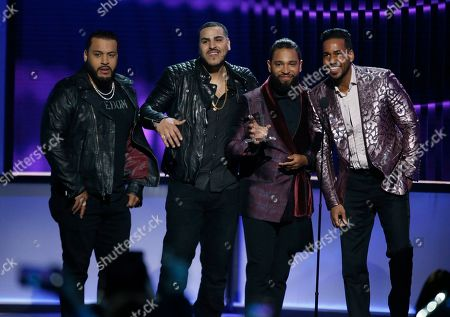 Lenny Santos, Max Santos, Henry Santos, Romeo Santos. Lenny Santos, from left, Max Santos, Henry Santos and Romeo Santos, of Aventura, accept the award for tropical artist of the year, duo or groupat the Billboard Latin Music Awards, at the Mandalay Bay Events Center in Las Vegas