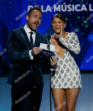 Erik Hayser, Sofia Reyes. Erik Hayser, left, and Sofia Reyes present the award for tropical solo artist of the year at the Billboard Latin Music Awards, at the Mandalay Bay Events Center in Las Vegas