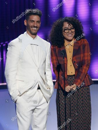 Stock Image of Erick Elias, Elyfer Torres. Erick Elias, left, and Elyfer Torres present the award for airplay song of the year at the Billboard Latin Music Awards, at the Mandalay Bay Events Center in Las Vegas