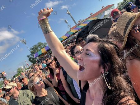 Kelly Grace, of Philadelphia, grooves to the music of Alanis Morissette at the Gentilly Stage at the New Orleans Jazz & Heritage Festival in New Orleans