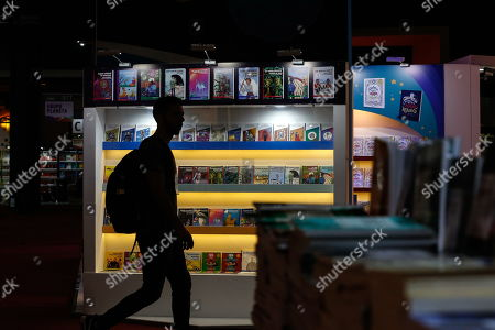 A man walks in front of a book stand during the first day of the 45th International Book Fair of Buenos Aires, in Buenos Aires, Argentina, 25 April 2019. The fair, considered the largest in South America, will run until 13 May and will bring together prominent authors such as Arturo Perez-Reverte, Rosa Montero and John Katzenbach. Barcelona, Spain is this year?s guest city of honor.