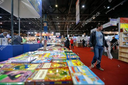 People look at exhibits during the first day of the 45th International Book Fair of Buenos Aires, in Buenos Aires, Argentina, 25 April 2019. The fair, considered the largest in South America, will run until 13 May and will bring together prominent authors such as Arturo Perez-Reverte, Rosa Montero and John Katzenbach. Barcelona, Spain is this year?s guest city of honor.