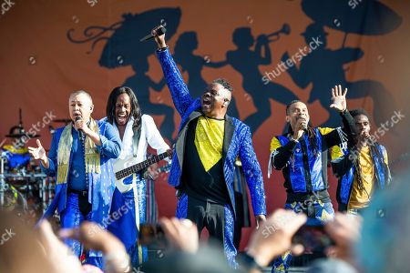 Stock Picture of Ralph Johnson, Verdine White, B. David Whitworth, Philip Bailey. Ralph Johnson, from left, Verdine White, B. David Whitworth, and Philip Bailey of Earth, Wind & Fire perform at the New Orleans Jazz and Heritage Festival, in New Orleans