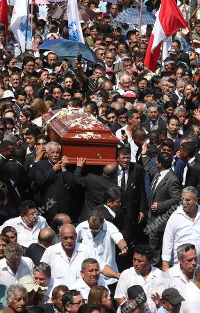 Stock Picture of People carry the coffin of Peru's late President Alan Garcia during his funeral procession in Lima, Peru. Garcia shot himself in the head and died Wednesday as officers waited to arrest him in a massive graft probe that has put the country's most prominent politicians behind bars and provoked a reckoning over corruption