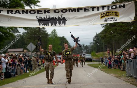 John Bergman, Michael Rose. U.S. Army Capts. Michael Rose, left, and John Bergman, both of the 101th Airborne Division, cross the finish line to win the Best Ranger competition, at Fort Benning, Ga