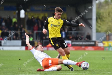 27th April 2019, Pirelli Stadium, Burton upon Trent, England; Sky Bet League One, Burton Albion vs Luton Town ; James Collins (19) of Luton Town tackles Ben Fox (12) of Burton Albion  Credit: Jon Hobley/News Images English Football League images are subject to DataCo Licence