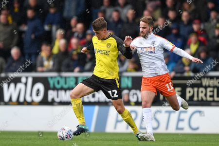 27th April 2019, Pirelli Stadium, Burton upon Trent, England; Sky Bet League One, Burton Albion vs Luton Town ; Ben Fox (12) of Burton Albion holds off Andrew Shinnie (11) of Luton Town  Credit: Jon Hobley/News Images English Football League images are subject to DataCo Licence