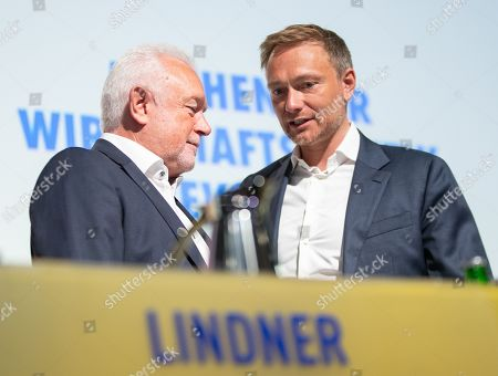 The vice president of the German Parliament Wolfgang Kubicki (L) and Free Democratic Party (FDP) chairman and faction chairman in the German parliament Bundestag Christian Lindner talk during a three day party convention of the Free Democratic Party (FDP) at the Station Berlin, in Berlin, Germany, 26 April 2019. The FDP party convention runs from 26 to 28 April.
