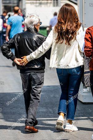 Former Formula One boss Bernie Ecclestone (L) with his wife Fabiana Flosi (R) at the Baku City Circuit in Baku, Azerbaijan, 26 April 2019. The 2019 Formula One Grand Prix of Azerbaijan will take place on 28 April.