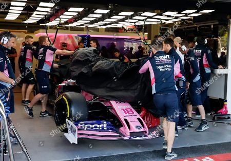 c08e9e8f59f Racing Point team members cower the damaged the car of Canada's driver  Lance Stroll during the