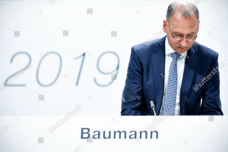 Werner Baumann, CEO of German pharmaceutical company Bayer, arrives for the annual shareholders meeting of Bayer AG at the World Conference Center (WCC) in Bonn, Germany, 26 April 2019. The company said the Bayer Group achieved a strong start to the year in its operational business. Sales of Bayer in the first quarter rose by 4.1 per cent on a currency- and portfolio-adjusted basis to 13.015 billion euros. EBIT declined by 15.6 per cent to 1.950 billion euros, after net special charges of 1.050 billion euros. The principal charges concerned were a total of 492 million euros in connection with the acquisition and integration of Monsanto, and 393 million euros pertaining to the announced restructuring. Net income declined by 36.5 per cent to 1.241 billion euros due to high special charges. Bayer's free cash flow almost doubled to 508 million euros.