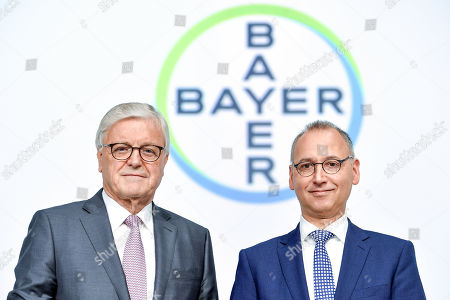 The Chairman of the supervisory board Werner Wenning (L) and CEO Werner Baumann (R) of German pharmeceutical company Bayer pose during the annual stockholders' meeting of Bayer AG at the World Conference Center (WCC) in Bonn, Germany, 26 April 2019. The company said the Bayer Group achieved a strong start to the year in its operational business. Sales of Bayer in the first quarter rose by 4.1 per cent on a currency- and portfolio-adjusted basis to 13.015 billion euros. EBIT declined by 15.6 per cent to 1.950 billion euros, after net special charges of 1.050 billion euros. The principal charges concerned were a total of 492 million euros in connection with the acquisition and integration of Monsanto, and 393 million euros pertaining to the announced restructuring. Net income declined by 36.5 per cent to 1.241 billion euros due to high special charges. Bayer's free cash flow almost doubled to 508 million euros.