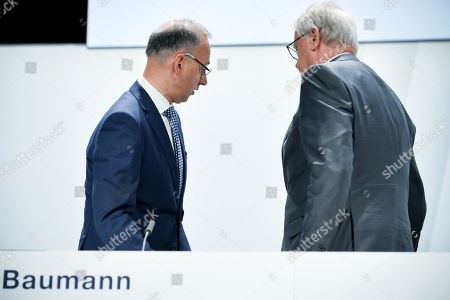 The Chairman of the supervisory board Werner Wenning (R) and CEO Werner Baumann (L) of German pharmeceutical company Bayer, react during the annual stockholders' meeting of Bayer AG at the World Conference Center (WCC) in Bonn, Germany, 26 April 2019. The company said the Bayer Group achieved a strong start to the year in its operational business. Sales of Bayer in the first quarter rose by 4.1 per cent on a currency- and portfolio-adjusted basis to 13.015 billion euros. EBIT declined by 15.6 per cent to 1.950 billion euros, after net special charges of 1.050 billion euros. The principal charges concerned were a total of 492 million euros in connection with the acquisition and integration of Monsanto, and 393 million euros pertaining to the announced restructuring. Net income declined by 36.5 per cent to 1.241 billion euros due to high special charges. Bayer's free cash flow almost doubled to 508 million euros.