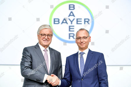 The Chairman of the supervisory board Werner Wenning (L) and CEO Werner Baumann (R) of German pharmeceutical company Bayer shake hands during the annual shareholders' meeting of Bayer AG at the World Conference Center (WCC) in Bonn, Germany, 26 April 2019. The company said the Bayer Group achieved a strong start to the year in its operational business. Sales of Bayer in the first quarter rose by 4.1 per cent on a currency- and portfolio-adjusted basis to 13.015 billion euros. EBIT declined by 15.6 per cent to 1.950 billion euros, after net special charges of 1.050 billion euros. The principal charges concerned were a total of 492 million euros in connection with the acquisition and integration of Monsanto, and 393 million euros pertaining to the announced restructuring. Net income declined by 36.5 per cent to 1.241 billion euros due to high special charges. Bayer's free cash flow almost doubled to 508 million euros.