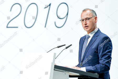 Werner Baumann, CEO of German pharmaceutical company Bayer, delivers a speech during the annual shareholders' meeting of Bayer AG at the World Conference Center (WCC) in Bonn, Germany, 26 April 2019. The company said the Bayer Group achieved a strong start to the year in its operational business. Sales of Bayer in the first quarter rose by 4.1 per cent on a currency- and portfolio-adjusted basis to 13.015 billion euros. EBIT declined by 15.6 per cent to 1.950 billion euros, after net special charges of 1.050 billion euros. The principal charges concerned were a total of 492 million euros in connection with the acquisition and integration of Monsanto, and 393 million euros pertaining to the announced restructuring. Net income declined by 36.5 per cent to 1.241 billion euros due to high special charges. Bayer's free cash flow almost doubled to 508 million euros.