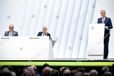 Werner Baumann (R), CEO of German pharmaceutical company Bayer, delivers a speech during the annual shareholders' meeting of Bayer AG at the World Conference Center (WCC) in Bonn, Germany, 26 April 2019. The company said the Bayer Group achieved a strong start to the year in its operational business. Sales of Bayer in the first quarter rose by 4.1 per cent on a currency- and portfolio-adjusted basis to 13.015 billion euros. EBIT declined by 15.6 per cent to 1.950 billion euros, after net special charges of 1.050 billion euros. The principal charges concerned were a total of 492 million euros in connection with the acquisition and integration of Monsanto, and 393 million euros pertaining to the announced restructuring. Net income declined by 36.5 per cent to 1.241 billion euros due to high special charges. Bayer's free cash flow almost doubled to 508 million euros.