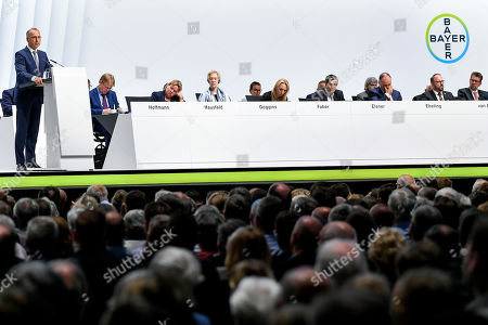 Werner Baumann (L), CEO of German pharmaceutical company Bayer, delivers a speech during the annual shareholders' meeting of Bayer AG at the World Conference Center (WCC) in Bonn, Germany, 26 April 2019. The company said the Bayer Group achieved a strong start to the year in its operational business. Sales of Bayer in the first quarter rose by 4.1 per cent on a currency- and portfolio-adjusted basis to 13.015 billion euros. EBIT declined by 15.6 per cent to 1.950 billion euros, after net special charges of 1.050 billion euros. The principal charges concerned were a total of 492 million euros in connection with the acquisition and integration of Monsanto, and 393 million euros pertaining to the announced restructuring. Net income declined by 36.5 per cent to 1.241 billion euros due to high special charges. Bayer's free cash flow almost doubled to 508 million euros.