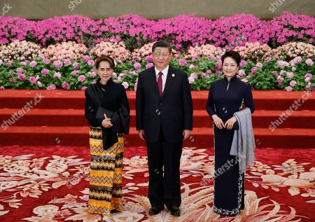 Myanmar State Councellor Aung San Suu Kyi (L) is welcomed by Chinese President Xi Jinping (C) and his wife Peng Liyuan for a welcoming banquet at the Belt and Road Forum at the Great Hall of the People in Beijing, China, 26 April 2019. Beijing hosts the Second Belt and Road Forum for International Cooperation