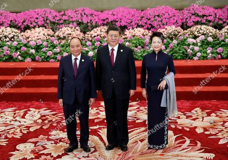 Vietnam's Prime Minister Nguyen Xuan Phuc (L) is welcomed by Chinese President Xi Jinping (C) and his wife Peng Liyuan for a welcoming banquet at the Belt and Road Forum at the Great Hall of the People in Beijing, China, 26 April 2019. Beijing hosts the Second Belt and Road Forum for International Cooperation